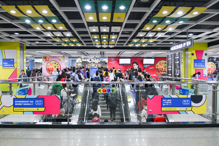 GUANGZHOU, CHINA - APR 02, 2017: Passengers at  subway station in Guangzhou city. The busy and rush life of crowed people on April, 02 2017.