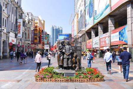 GUANGZHOU, CHINA - APR 02: Shopping in shangxia jiu pedestrian shopping street on April 02, 2017 in Guangzhou, shangxia jiu pedestrian shopping street is the main shopping street in Guangzhou. Editorial