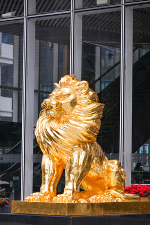 ancient lion: Gold Lion statue in front of building