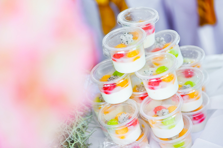 Pudding fruit salad , fruit salad topping on tofu Stock Photo