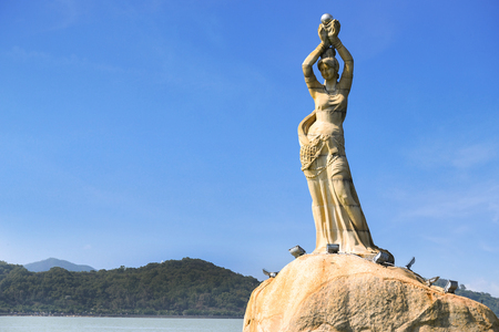 Zhuhai, Guangdong, China -APR 16, 2017: The Zhuhai Fisher Girl Statue is the landmark of Zhuhai city, located at the coast of Xianglu Bay on APRIL 16, 2017