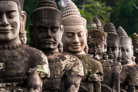 southgate: The stone of buddha image at Stone Gate of Angkor Thom in Cambodia Editorial