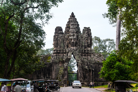 southgate: SIEM REAP, CAMBODIA - AUG 04, 2017: Stone Gate of Angkor Thom in Siem reap, Cambodia.