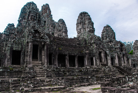 Prasat Bayon with smiling stone faces is the central temple of Angkor Thom Complex, Siem Reap, Cambodia. Ancient Khmer architecture and famous Cambodian landmark, World Heritage. Editorial