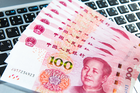 Yuan or RMB, Chinese Currency on laptops keyboard