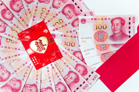 Yuan or RMB, Chinese Currency with red envelope