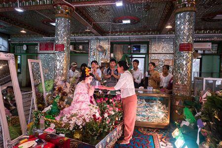 YANGON, MYANMAR - JULY 23, 2016 :  Burmese and tourists offering for god at Bo Ta Tuang Paya Temple in Botahtaung Pagoda in Yangon. Editöryel
