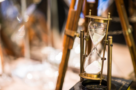Hourglass is passing down, time concept