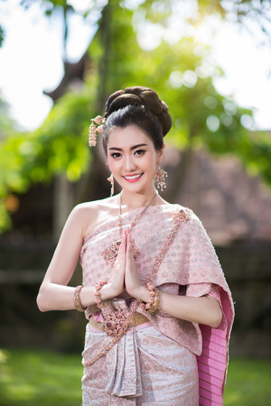 Beautiful Thai girl in Thai traditional costume. Stock Photo