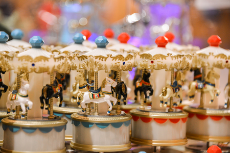 Miniature Musical carousel with horses, merry-go-round toy. Stock Photo