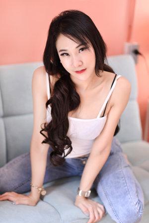The pretty asian girl is in happy action indoor