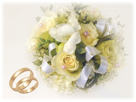 wedding bouquet with gold wedding rings on white background Stock Photo - 9141774