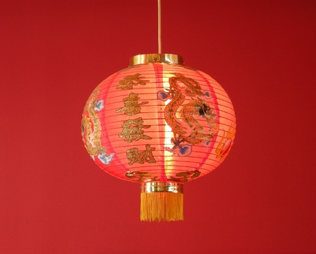 red chinese paper lantern on red background photo