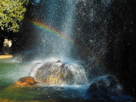 A rainbow in a waterfall.