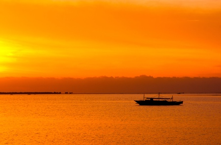 palawan: Philippine boat anchored at sea on a sunset.