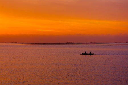palawan: Two man fishing on a sunset. Stock Photo