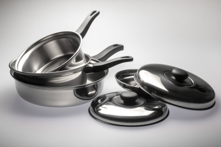 Clean and shiny stainless steel pots and pans.