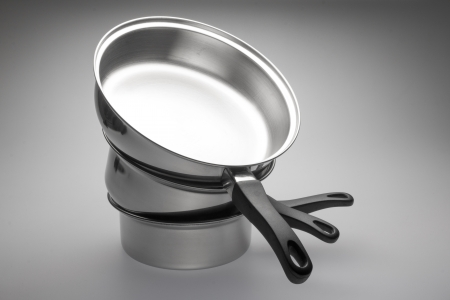 pan: Clean and shiny stainless steel pots and pans.
