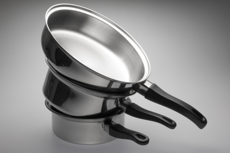 pans: Clean and shiny stainless steel pots and pans.