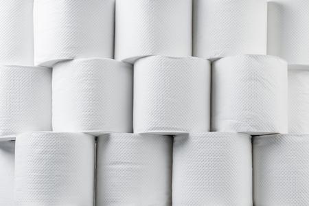 tissue paper: Stack of white tissue paper rolls.