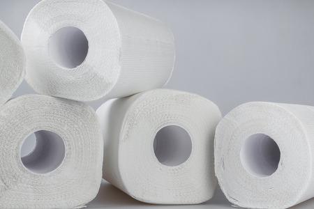 tissue texture: Stack of white tissue paper rolls.