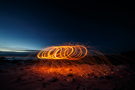 Spinning steel wool at sunset