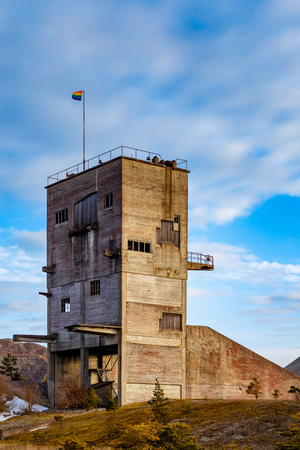 Old concrete building with rainbow flag on the roof