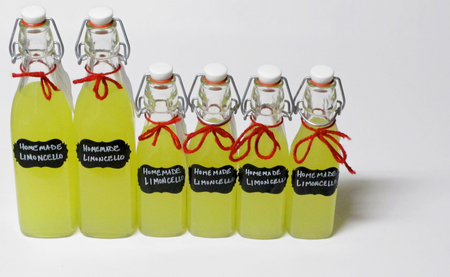 Homemade Limoncello in Swing Top Bottles Stock Photo