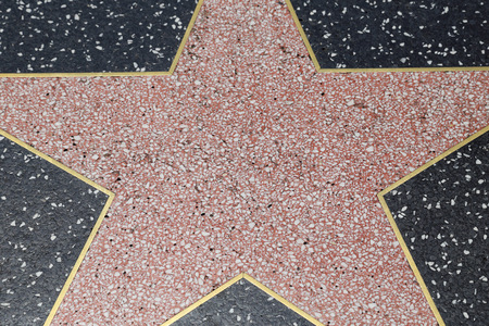 unmarked: LOS ANGELES, CAUSA - June 30, 2016: Detail of a terrazzo and bronze star lining the Walk of Fame in Hollywood, California.