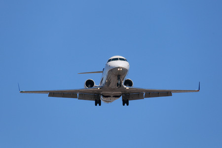 corporate jet: Corporate Jet Approaching for Landing Stock Photo