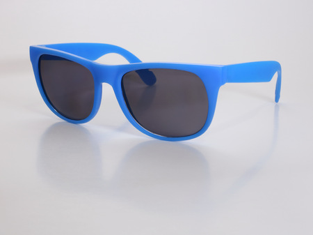 Blue Sunglasses Isolated Against White Background