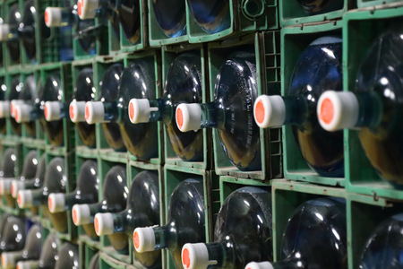 Rows of Large, Water Cooler Bottles in Storage Stock Photo