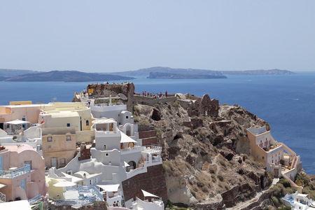 Byzantine castle ruins and Aegean Sea view in the town of Oia, island of Santorini, Greece