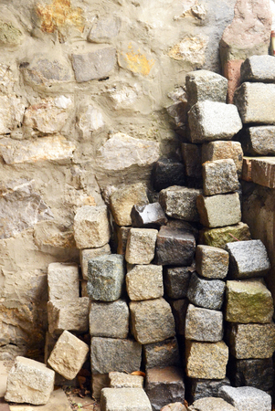Stone cubes on the stone wall background