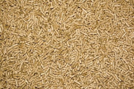 Compressed wood ecolgy pellet close up photo