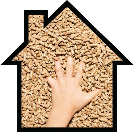 The shape of the house fill with wood pellet and recycle sign Фото со стока