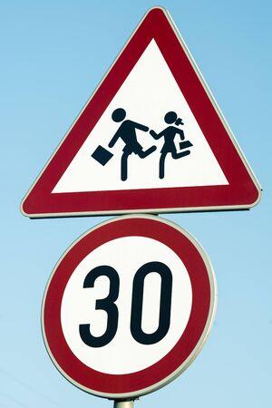 Road traffic sign caution children, 30 km speed limit sign near the school Foto de archivo