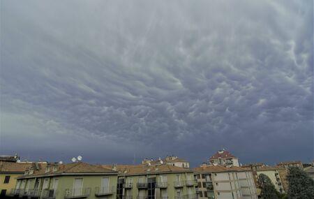 Dark rainy clouds over the Milano city