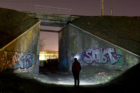 graffito: Man lighting railway bridge Editorial