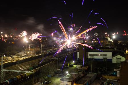 newyear night: Fireworks over a railway
