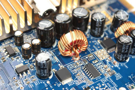 electronic components: choke on printed circuit board Stock Photo