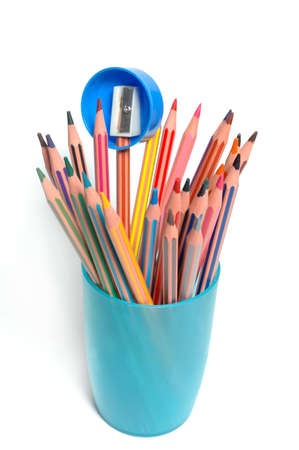 coloured pencils and pencil sharpener Stock Photo - 6343865