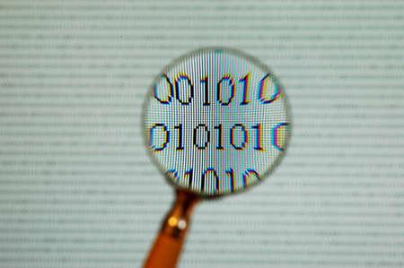 binary code close-up on computer screen photo