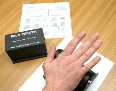 friction ridges: take off the palm prints on special stamp with black ink Stock Photo