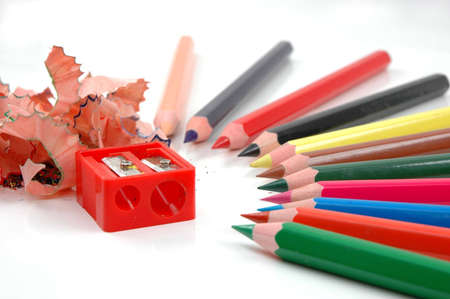 Sharpened coloured pencils and pencil sharpener photo