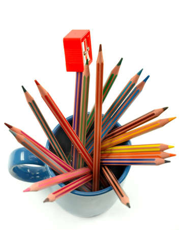 Many colored pencils and sharpener in mug Stock Photo - 6770285
