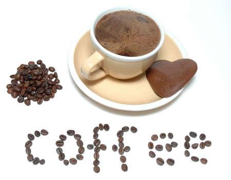 Coffee and heart chocolade photo