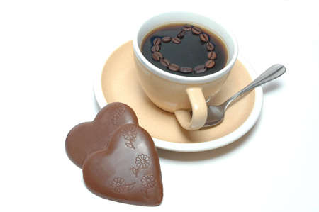 Coffee and chocolate hearts on plate photo