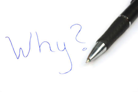 hand written: Written on the paper WHY? and pen next to it