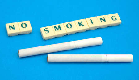 Cigarettes and '' no smoking'' warning Stock Photo - 7123383